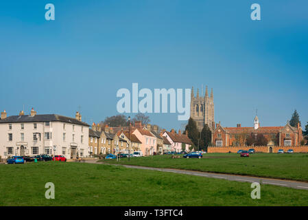 Long Melford Suffolk, view of The Green, the tower of Holy Trinity Church and Tudor hospital (right) in Long Melford village, Suffolk, England, UK. - Stock Image
