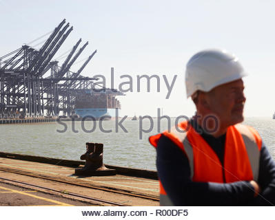 Cranes and cargo ship at Port of Felixstowe, England - Stock Image