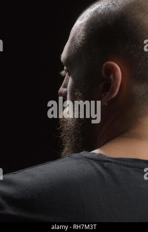 Profile serious man with beard and earring - Stock Image