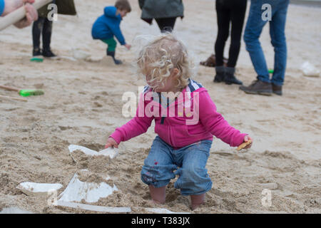 St Ives, Cornwall, UK. 7th April 2019. The public were invited to cover the beach at St Ives with tiny mountains, made from moulds to represent Mount Kilmanjaro,  Shasta, Fuji, Stromboli and Ulura. The event today organised by the Tate St Ives is one of several taking place around the UK in conjunction with artist Katie Paterson. Credit: Simon Maycock/Alamy Live News - Stock Image