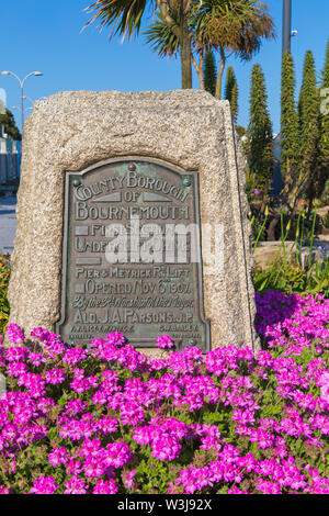 Commemorative plaque on stone at Pier Approach, Bournemouth, Dorset UK in July - Stock Image