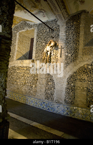 Wall decorated with the mummified bodies of two human beings believed to be father and son, Evora, Alentejo, Portugal, - Stock Image