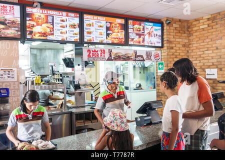 Cartagena Colombia Bocagrande Burger King fast food hamburgers restaurant inside counter customers cashier taking order Hispanic resident residents te - Stock Image
