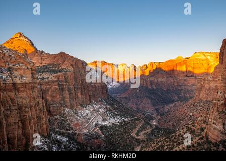 View from Canyon Overlook into Zion Canyon with snow, at sunrise, back left Bridge Mountain, Zion National Park, Utah, USA - Stock Image