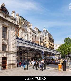 London cityscape: exterior façade and entrance canopy of London Victoria Station, City of Westminster, London, UK, a major transport terminus - Stock Image