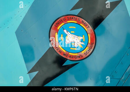 Insignia of the U.S. Navy Fighter Weapons School also known as 'Top Gun' on the tail of one of their aircraft. - Stock Image
