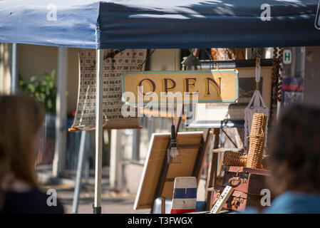An antique Open sign and other Bric a Brac at a community market in the inner Sydney suburb of Surry Hills, NSW, Australia - Stock Image
