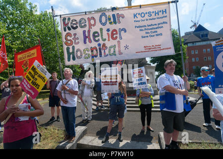 London, UK. 7th July 2018. Keep Our St Helier Hospital (KOSHH) campaigners against the closure of acute facilities at Epsom and St Helier Hospitals in south London pose before their march to celebrate the 70th Birthday of the NHS with a march from Sutton to a rally in front of St Helier Hospital.  The closures are prompted by government cuts which call for huge savings by the trust, and would Credit: Peter Marshall/Alamy Live News - Stock Image