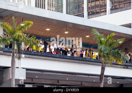 Spectators line elevated Metrorail track watching 2014 Mercedes-Benz Corporate Run in Miami, Florida, USA. - Stock Image