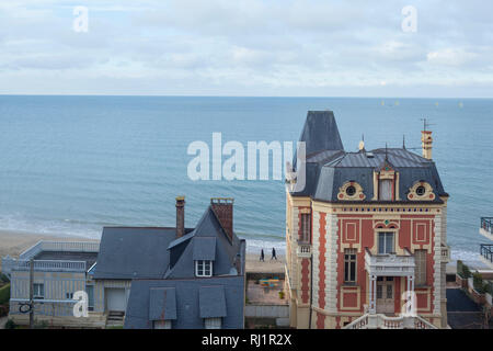 Looking out over the Seine towards Le Havre beyond iconic Belle Epoque houses in Trouville-sur-Mer, Normandy, France. - Stock Image