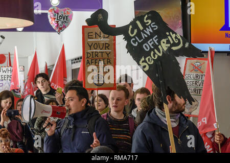 London, UK. 14th February 2019. IWGB President Henry Chango Lopez  speaks inside the Richard Hoggart Building as they launch their campaign for Goldmsiths, University of London, to directly employ its security officers. Currently they are employed by CIS Security Ltd on low pay and minimal conditions of service, and CIS routinely flouts its legal responsibilities on statutory sick pay and holidays. Credit: Peter Marshall/Alamy Live News - Stock Image