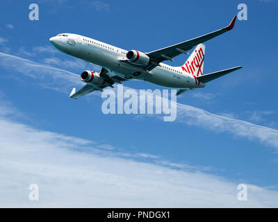 Sydney, New South Wales, Australia - October 4. 2014: Virgin Australia commercial passenger jet aircraft in flight closeup departing Sydney - Stock Image