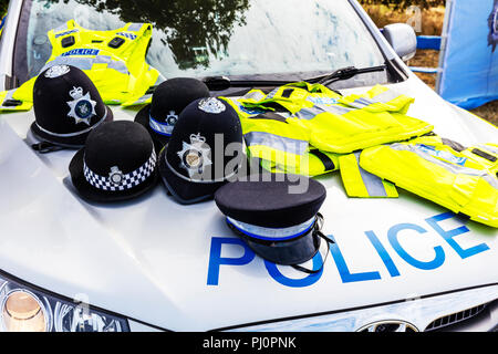 UK police helmet, UK police helmets, UK police, UK police clothing, UK police uniform, Police hats, UK police, police, UK, England, uniform, helmet, - Stock Image