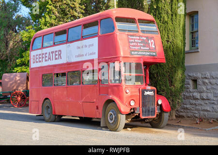 Vintage London double decker bus brought to the Karoo and used as tour bus to visit the village of Matjiesfontein, South Africa - February 20, 2019 - Stock Image