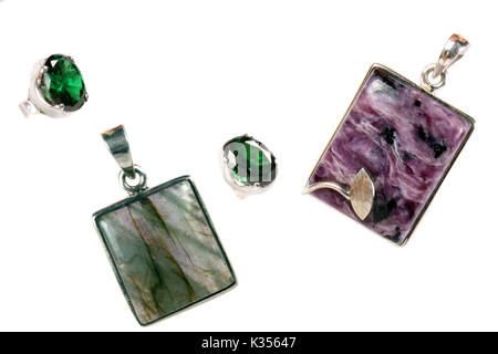 A set of pendants and rings made of silver and semi-precious stones of different colors. - Stock Image