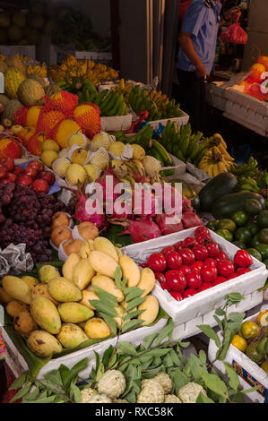 A typical market stall with fruits and vegetables on display for sale, Hanoi, Vietnam - Stock Image