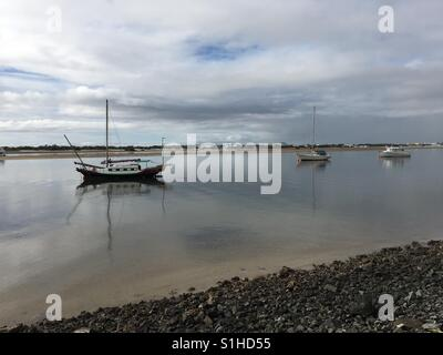 Boats in the sea on a still morning at The Gold Coast in Australia - Stock Image