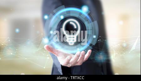 businessman hand with digital technology lightbulb concept - Stock Image