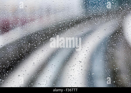 water droplets abstract rain background curve lines - Stock Image