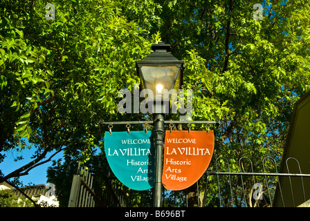 La Villita historic arts village red blue banners street lamp san Antonio texas tx tourist attraction shopping district - Stock Image