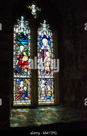 Beautiful stained glass window in an English Church - Stock Image