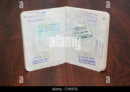 Open Passport with Stamps - Stock Image