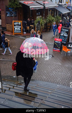 Brighton, UK. 09th Apr, 2019.  Umbrella weather in Brighton city centre on a grey wet day on the south coast but the forecast is set to improve over the next few days throughout Britain Credit: Simon Dack/Alamy Live News - Stock Image