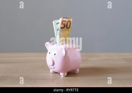 piggy bank or piggybank money box filled with euro banknotes - finance and savings concept with copy space - Stock Image