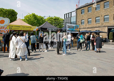 Food Stalls including Yaay Yaay and Da Fish Ting with people in front queuing Granary Square Kings Cross, London Borough of Camden England Britain UK - Stock Image