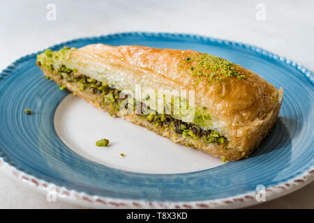 Turkish Baklava with Pistachio served with Plate / Havuc Dilimi. Traditional Dessert. - Stock Image