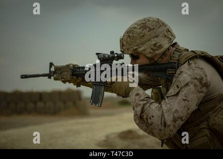 U.S. Marine Corps 1st Lt. Casey Lamar, a ground intelligence officer with Weapons Company, 3rd Battalion, 4th Marines, attached to Special Purpose Marine Air Ground Task Force Crisis Response-Central Command, calibrates his weapon during a battle sight zero range in Southwest Asia March 14, 2019. SPMAGTF-CR-CC is specifically designed to be capable of deploying aviation, ground, and logistics forces forward at a moment's notice. - Stock Image