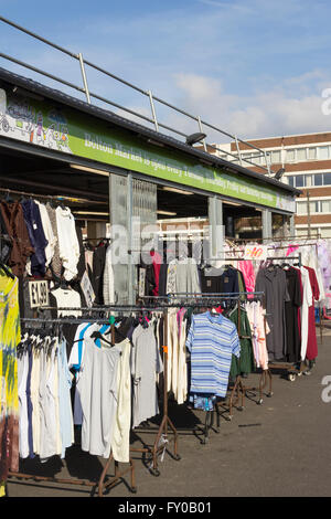 Outdoor stalls  in the new semi-open market canopy, mostly selling clothing, on Bolton market, Ashburner Street. - Stock Image
