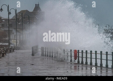 Penzance, Cornwall, UK. 27th November 2018. UK Weather. Strong winds, rain and waves batter the sea front at Penzance early this morning, as Storm Diana starts to approach the south west. Despite the winds and rain it was still a mild 14 degrees C at sunrise this morning. Credit: Simon Maycock/Alamy Live News - Stock Image