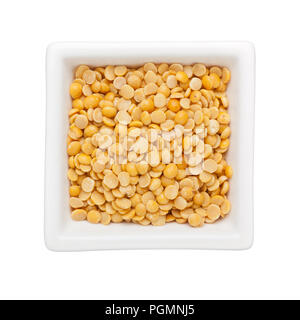 Split pigeon peas in a square bowl isolated on white background - Stock Image