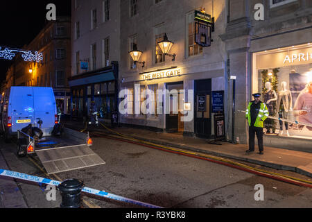 Bath Somerset UK, 24th November 2018  Police officer outside Westgate public house in bath as firecrew lay hose to put out fire  Credit Estelle Bowden/Alamy Live News - Stock Image