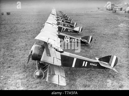 A line up of Sopwith Triplanes of the British Royal Air Force or Royal Flying Corps at an airfield during World War One. Serial numbers N5454 and N5475 nearest the camera. - Stock Image