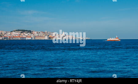 High perspective panorama of Lisbon old city center, view from Almada, Portugal with ferry boat crossing. - Stock Image
