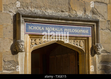 The inscription above a door to the Bodleian Library, Oxford 'Schola Moralis Philosophiae' in the Old Schools Quadrangle - Stock Image