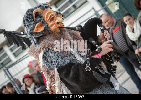 Animal theme Portuguese music band man playing bagpipes - Mealhada Carnaval parade - Portugal - Stock Image