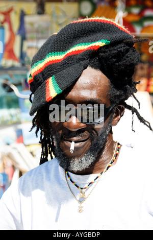 Jamaica Negril beach cool Rastafari man - Stock Image