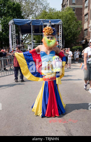 A man in drag with a very colorful costume at the 2019 Queens Pride Parade in Jackson Heights, Queens, New York City. - Stock Image