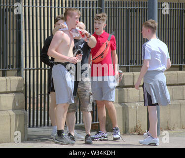 Glasgow, Scotland, UK. 12th July, 2019. Clyde street saw a blood incident that looked like a slashed throat on the road to TRNSMT festival at Glasgow Green as a good Samaritan tried to stop the flow to a young boy. Credit: gerard ferry/Alamy Live News - Stock Image