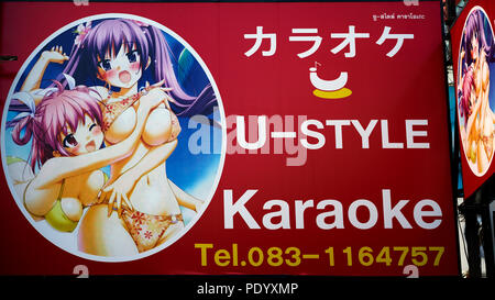 Advertising sign featuring scantily clad girls for a Japanese karaoke bar. Thailand Southeast Asia - Stock Image