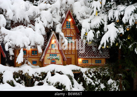 charming gingerbread type houses ,set in real snow ,are part of the outdoor nativity scene in Montemonaco,Le Marche,Italy - Stock Image