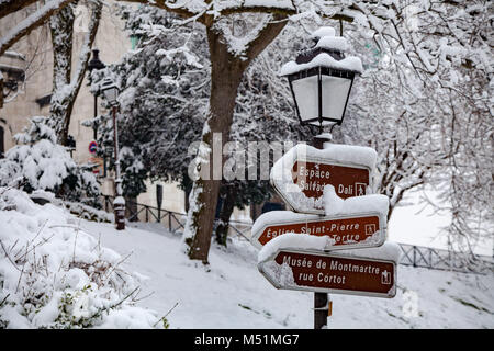 Snow covered street signs in Monmartre Paris - Stock Image