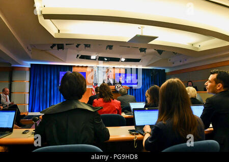 U.S. Secretary of State Mike Pompeo addresses reporters during the Department Press Briefing at the U.S. Department of State in Washington, D.C., on May 22, 2018. - Stock Image
