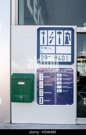 Information plate giving the list of activities authorised in a Spanish Garage - Stock Image