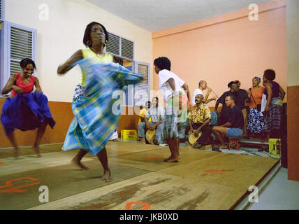 Traditional Belle dancers dance together at a local school in downtown Fort-de-France. They are part of a folk dance - Stock Image