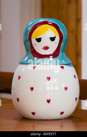 A Russian doll theme biscuit barrel designed by Ashley Thomas in UK - Stock Image