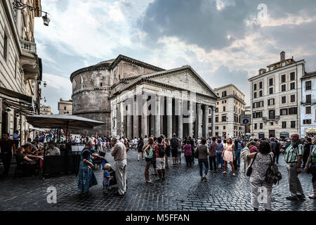 The crowded Piazza della Rotonda in Rome Italy as crowds of tourists enjoy the ancient temple and the lively sidewalk - Stock Image